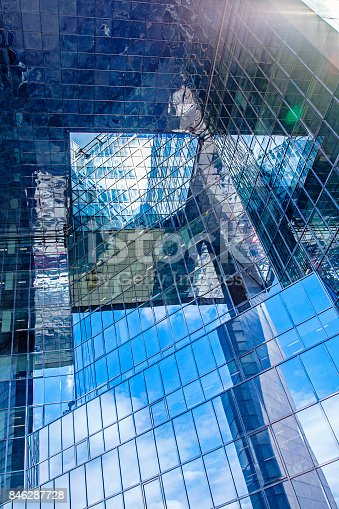 490774222istockphoto contemporary glass skyscraper reflecting the blue sky 846287728