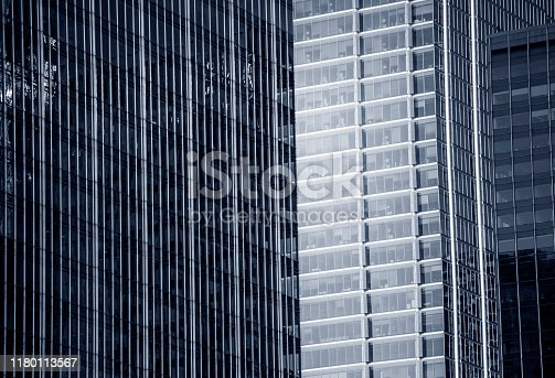 Contemporary glass skyscraper with reflection, texture ( Click for more)