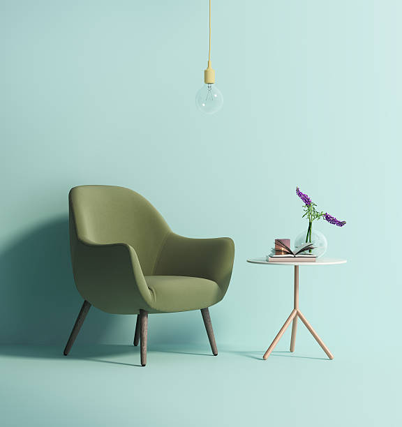 contemporary green armchair on mint wall - retro decor stock photos and pictures