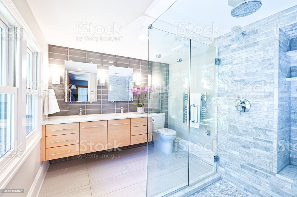 Contemporary Home Bathroom glass Shower Stall with Marble Tiles stock photo