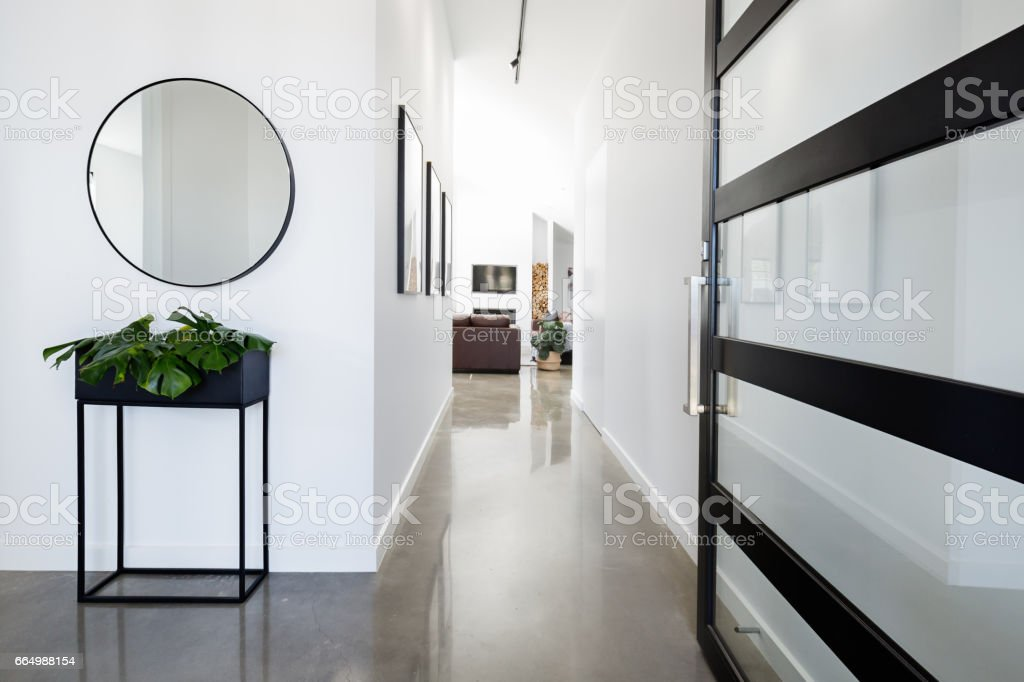 Contemporary home entry hall with polished floors stock photo