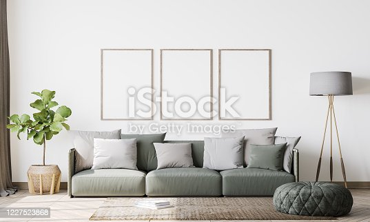 1095381860 istock photo Contemporary interior design for 3 poster frames mock up in living room. Vertical poster mock up. Stock photo 1227523868