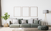 istock Contemporary interior design for 3 poster frames mock up in living room. Vertical poster mock up. Stock photo 1227523868