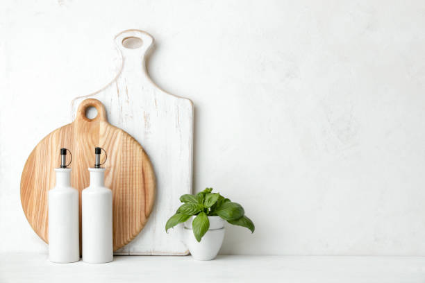 Contemporary kitchen background with blank space for a text Contemporary kitchen background with kitchen utensils standing on white countertop, blank space for a text, front view kitchen counter stock pictures, royalty-free photos & images
