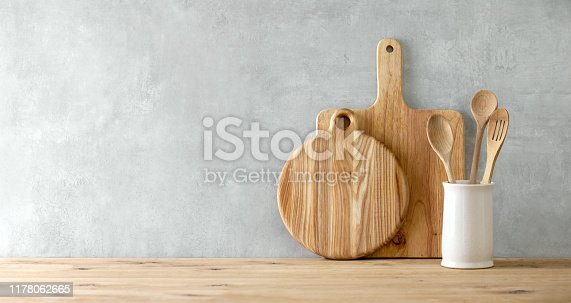 Contemporary kitchen background with kitchen utensils standing on wooden countertop,  blank space for a text, front view