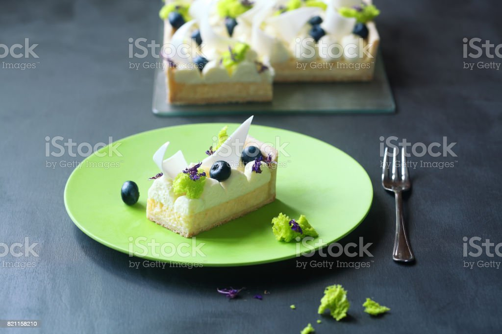 Contemporary Lemon Tart with Cream Cheese and Blueberries stock photo