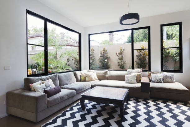 Contemporary living room with garden outlook stock photo