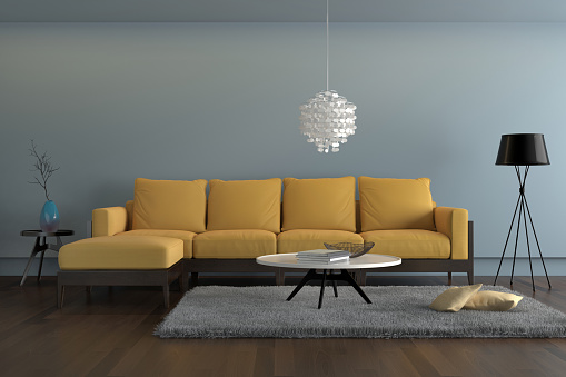 Contemporary Living Room With Yellow Sofa With Light Blue Wall Stock Photo  - Download Image Now