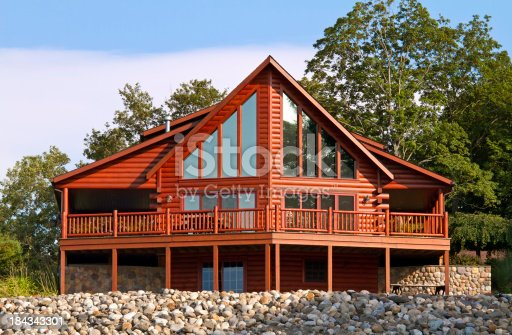 Elegant log home on a warm summer's day.