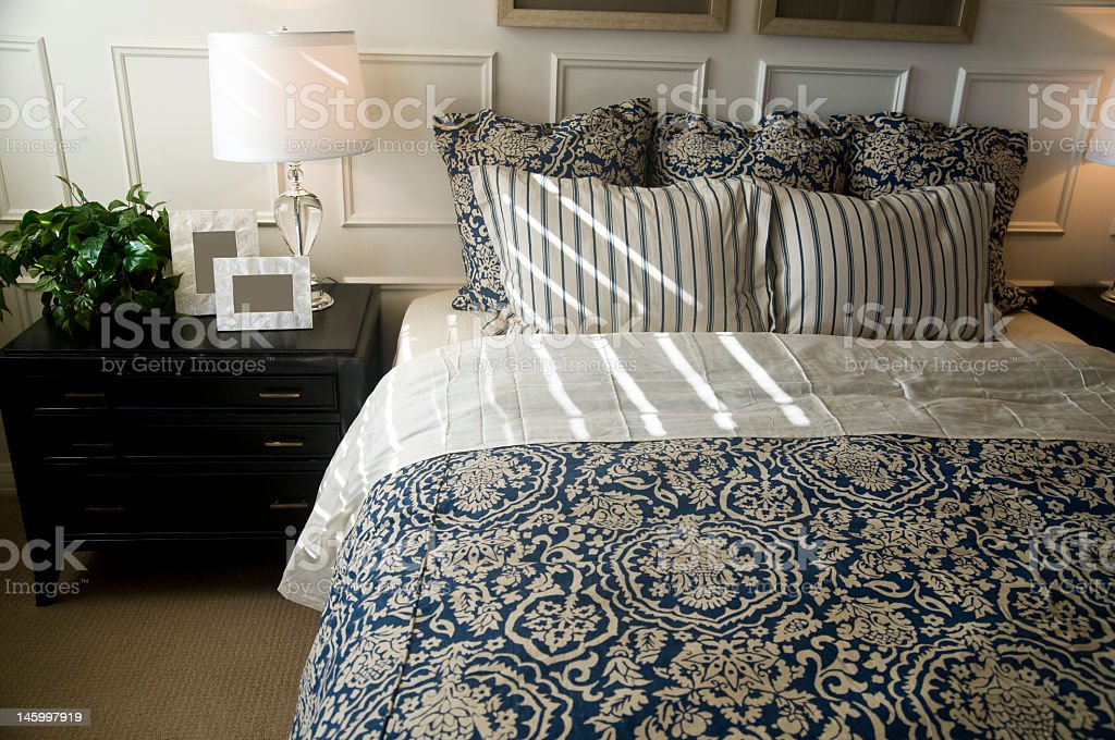 Contemporary luxurious blue and white bedroom set royalty-free stock photo