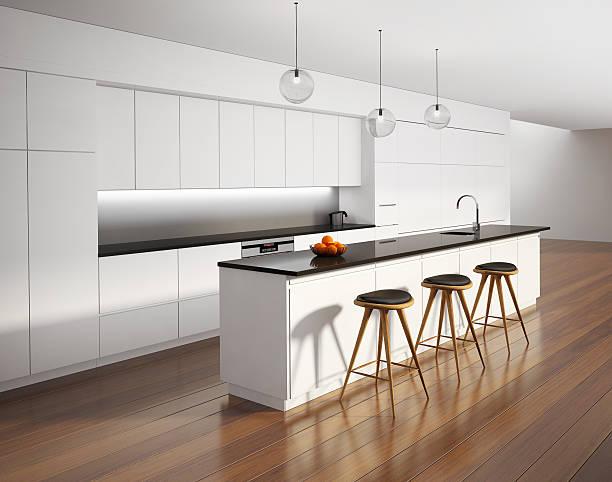 Contemporary minimal white kitchen with black details stock photo