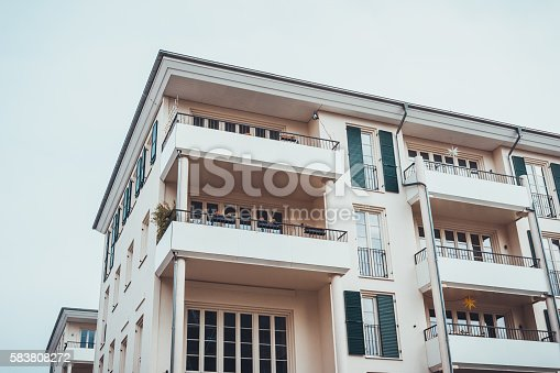 Contemporary multiple level lodgings with light colored facade on an overcast day