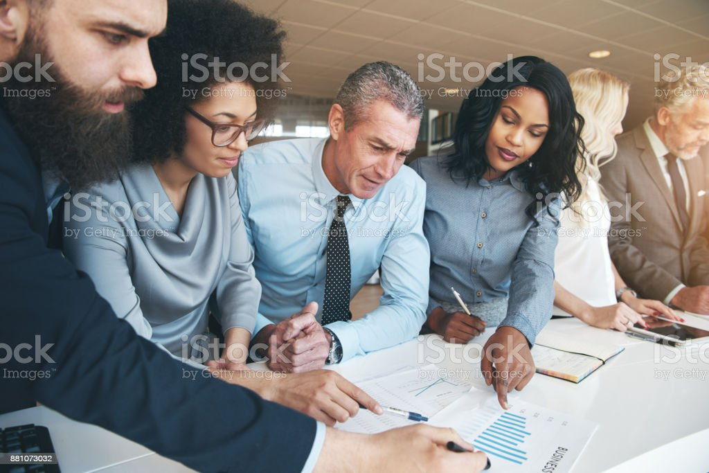 Contemporary multiracial team working on project in office stock photo
