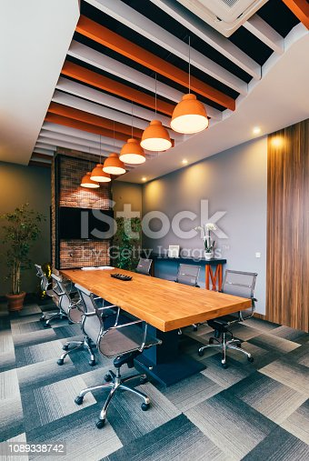 Empty colorful and modern style boardroom interior in office building ready for business meeting. XXXL size. Note: Furnitures from Sandalyeci A.S. Turkey