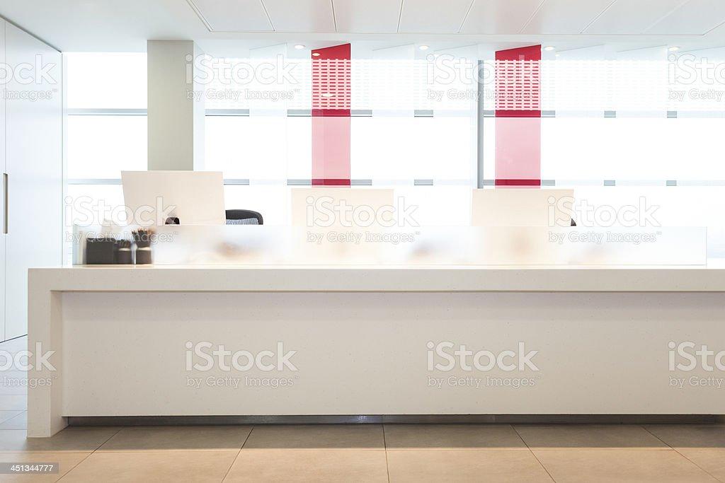 Contemporary Office Reception Desk in Modern Office Interior stock photo