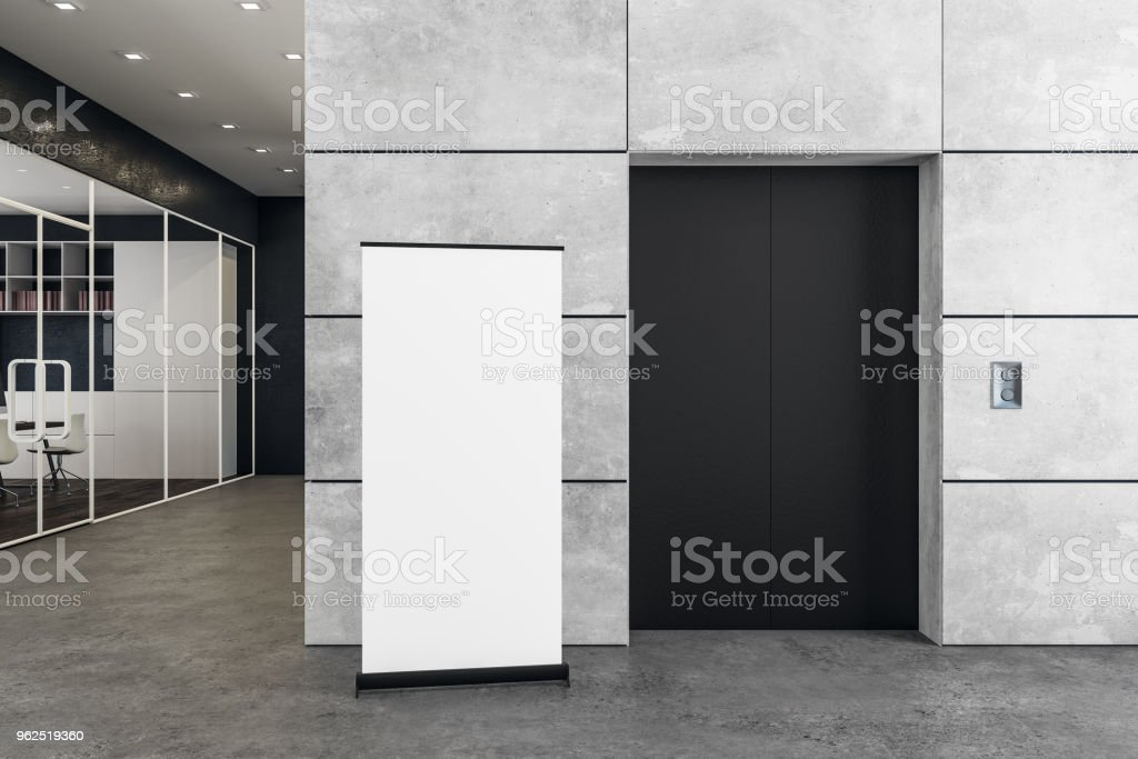 Contemporary office with elevator and poster stock photo