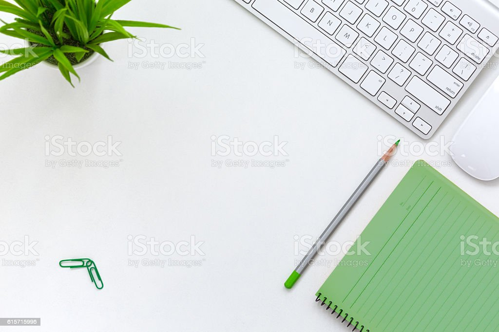 Contemporary Open Space Office white Table with Electronics and Flower stock photo