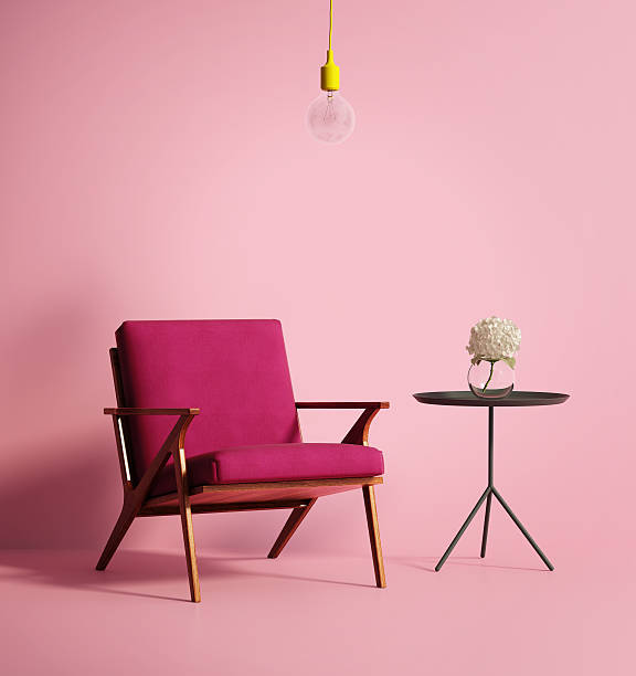 contemporary pink phux armchair - retro decor stock photos and pictures