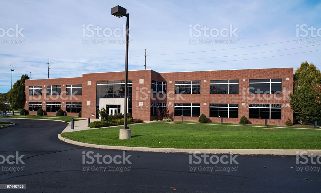 Contemporary Red Brick Building with Lamplight stock photo