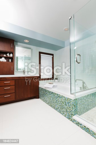 istock Contemporary Residential Bathroom with Shower Stall Vanity and Bath Tub 184624447