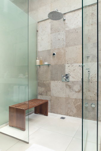 Modern rain shower with a bench.