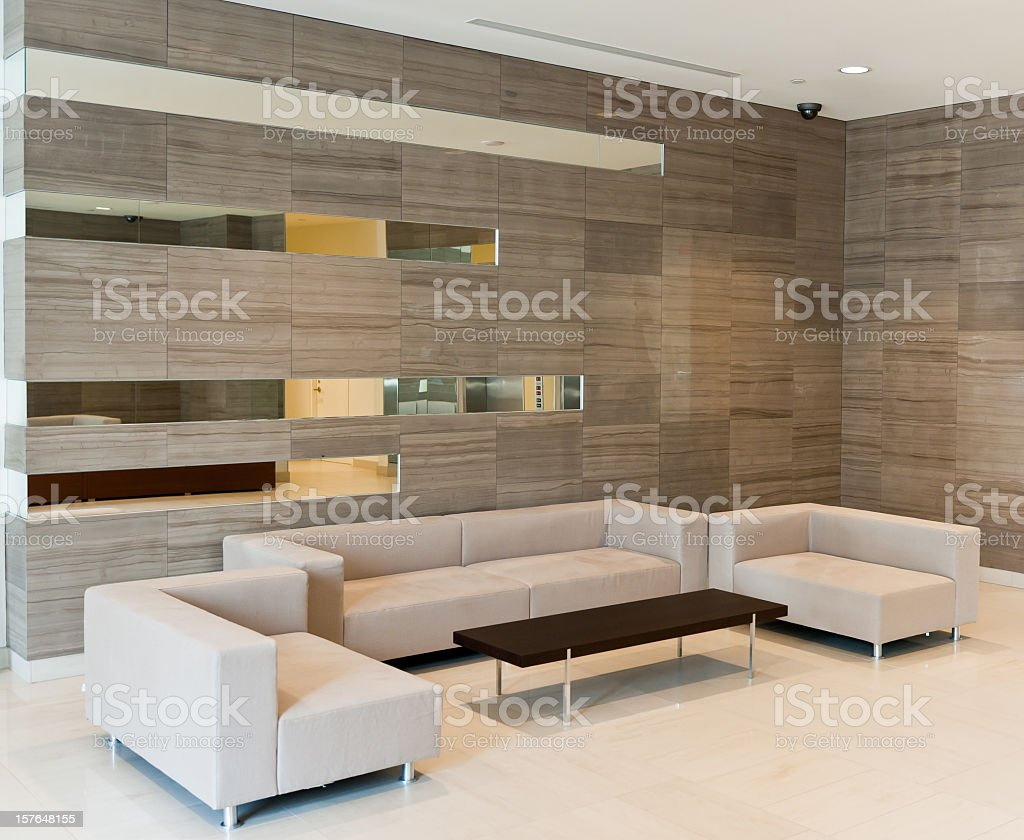 Contemporary sofa set on a modern building lobby royalty-free stock photo