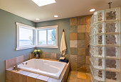 Contemporary upscale home spa bathroom interior with acrylic soaking tub