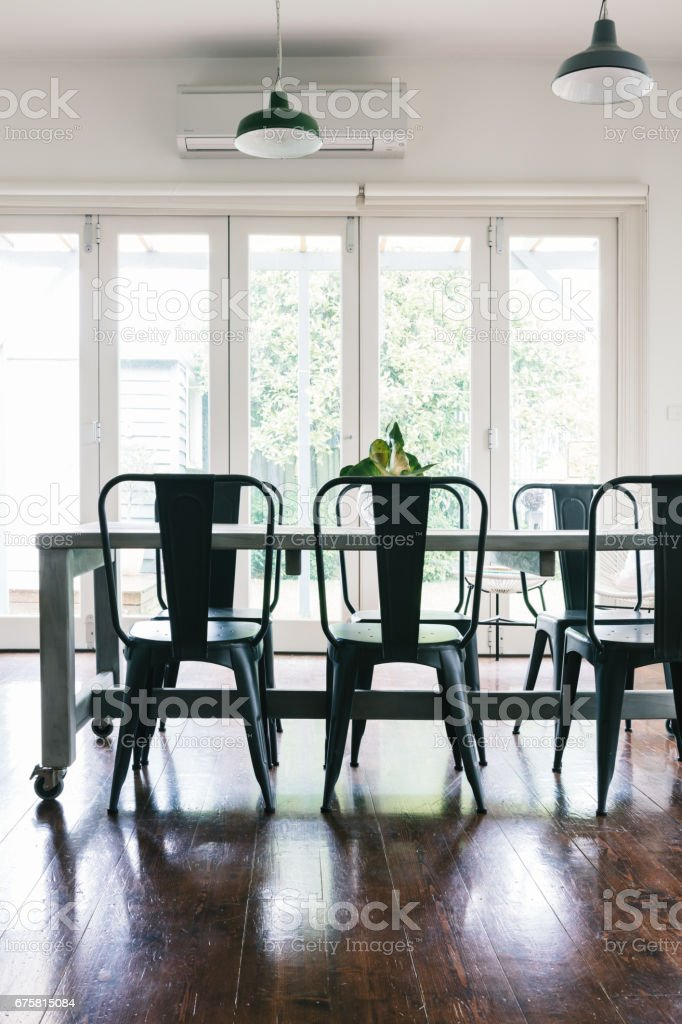 Contemporary vintage styled light bright dining room vertical stock photo
