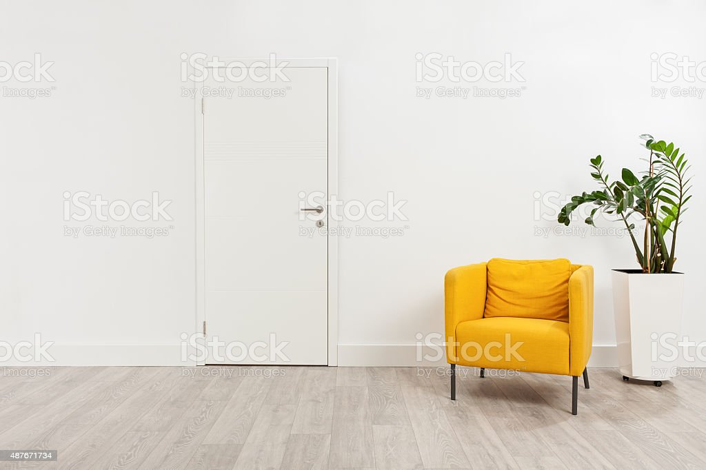 Contemporary waiting room with a yellow armchair stock photo