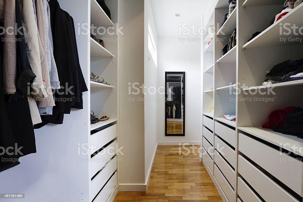 Contemporary walk in wardrobe Contemporary spacious walk in wardrobe in a modern home Australian Culture Stock Photo