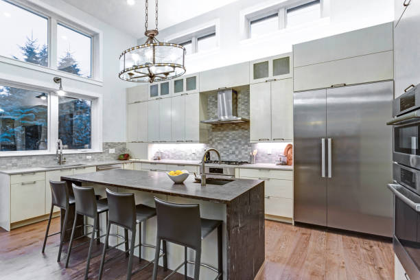 Contemporary white kitchen with high-end kitchen appliances stock photo