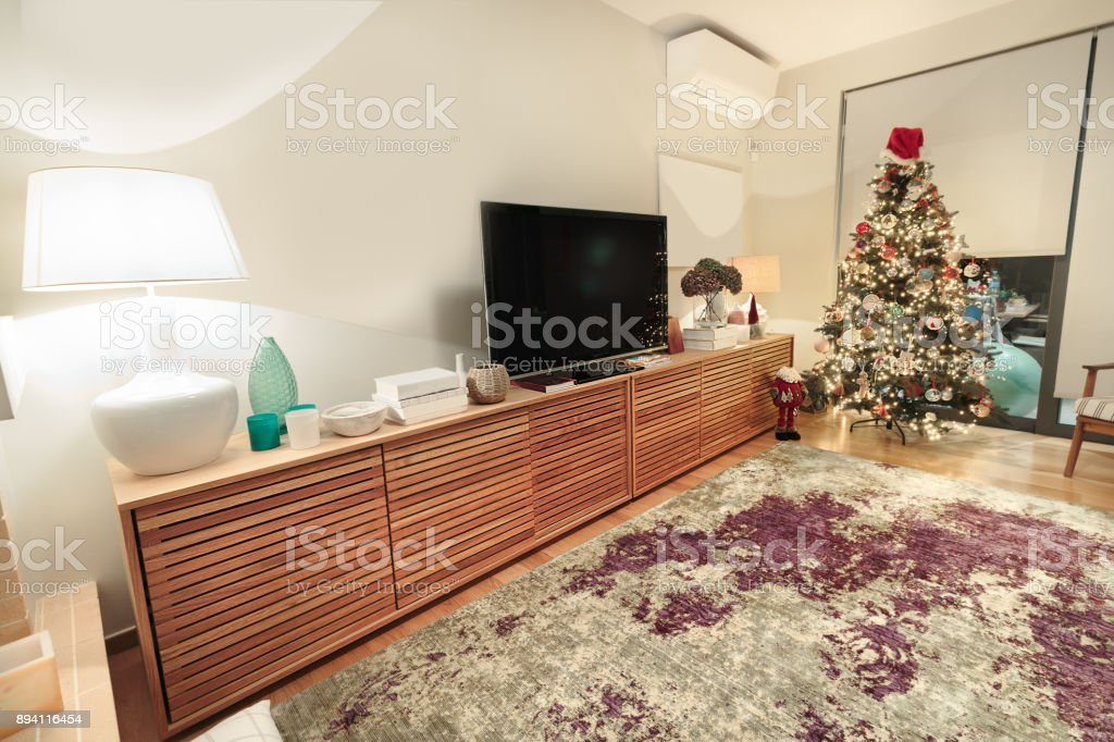Contemporary wooden living room cabinet with flat tv. stock photo