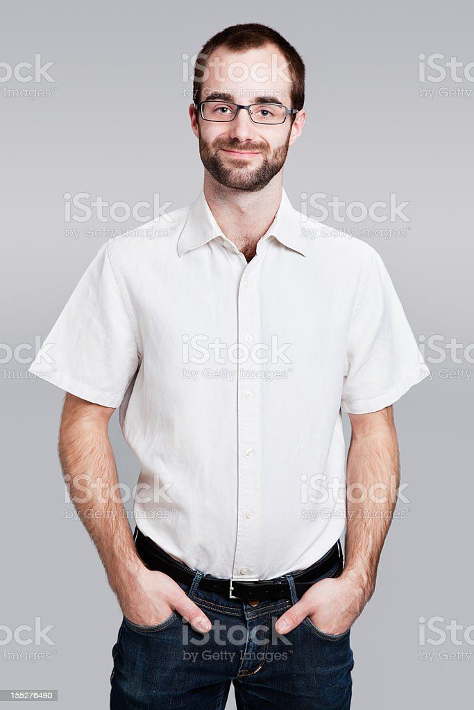 Contemporary worker with hands in pockets royalty-free stock photo