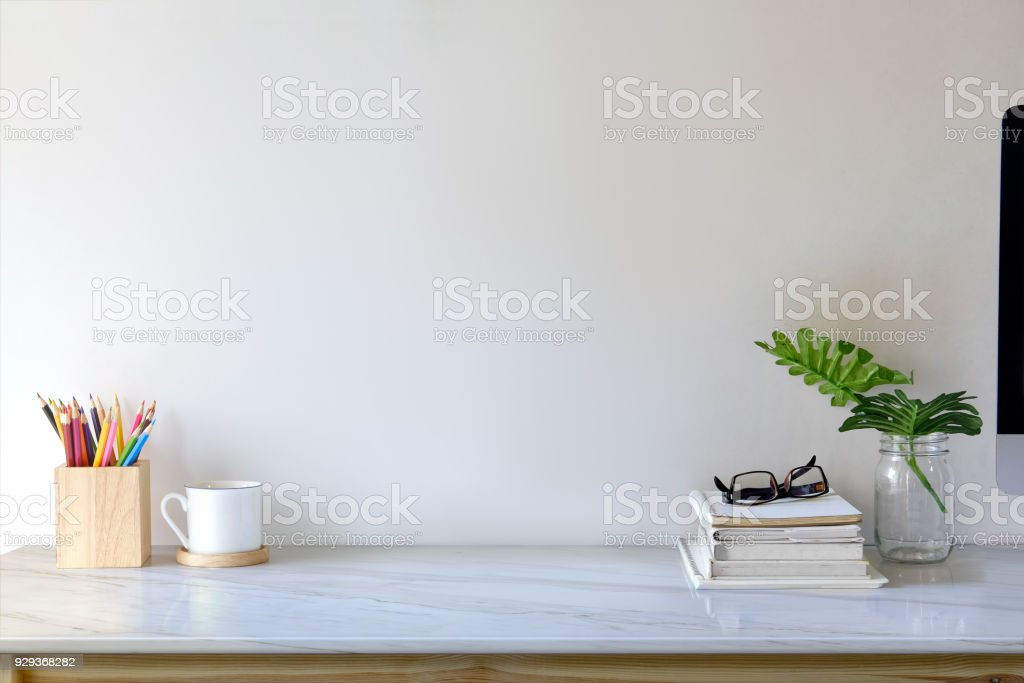 Contemporary workspace with books, colour pencils, gadgets and supplies. workspace and copy space stock photo