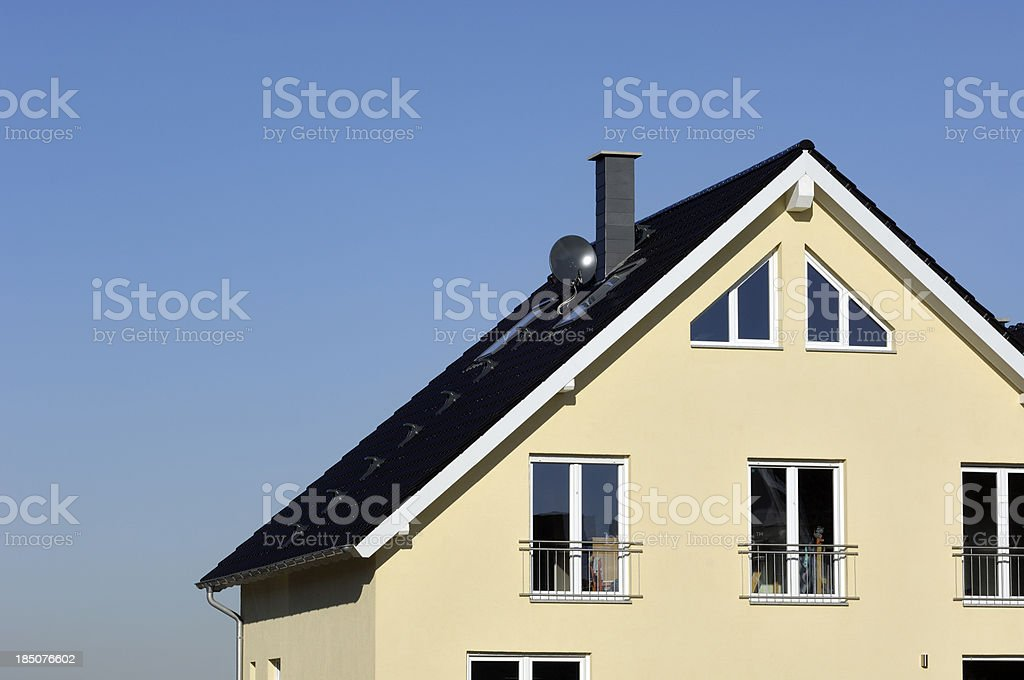 Contemporary yellow family house and blue sky royalty-free stock photo