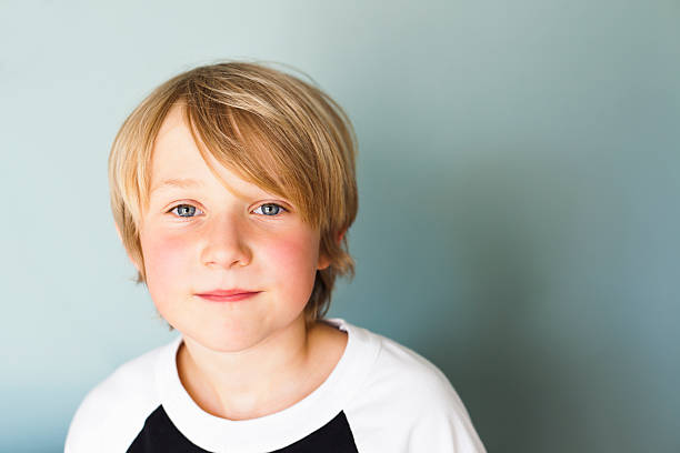 Content 9 Year Old Portrait of 9 year old boy.  Good copy space. 8 9 years stock pictures, royalty-free photos & images