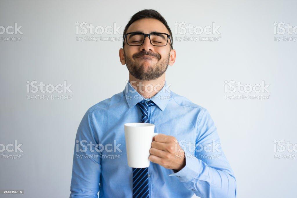 Content Business Man Enjoying Drinking Tea royalty-free stock photo