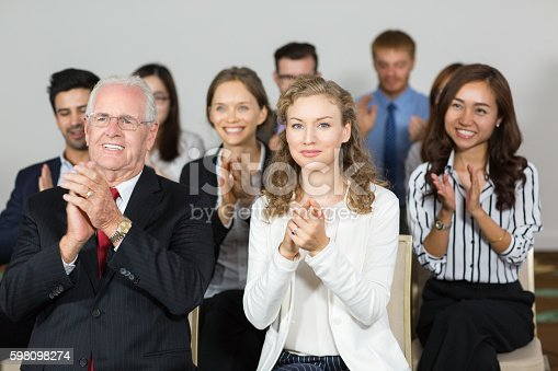 862718922 istock photo Content business people applauding to speaker after lecture 598098274