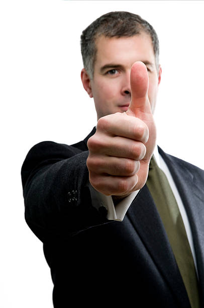 Content businessman gives a thmbs up. stock photo