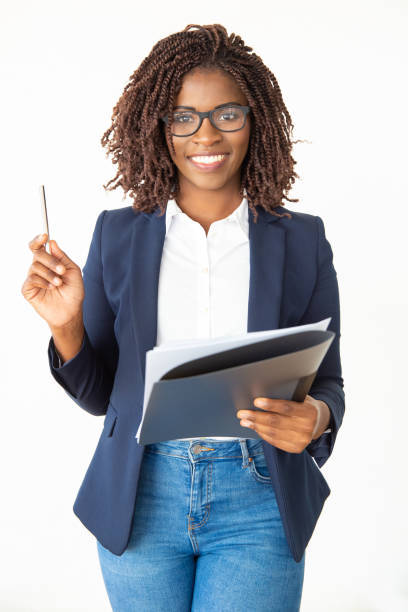 Content businesswoman holding folder and pen stock photo