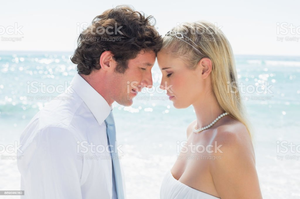 Content couple embracing each other on their wedding day stock photo