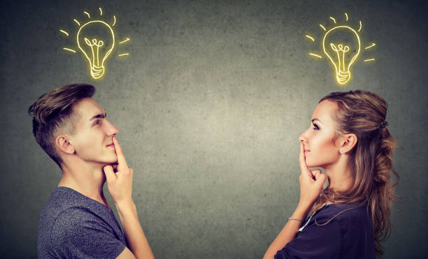 Content couple having great idea Young people man and woman posing together enlightened with idea looking positive. tuinkers stock pictures, royalty-free photos & images