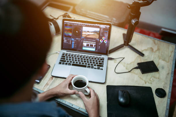 Content creator desk and equipment coffee cup and a laptop external hard disk in the house studio Content creator desk and equipment coffee cup and a laptop external hard disk in the house studio external hard disk drive stock pictures, royalty-free photos & images