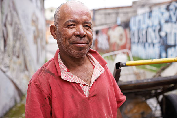 Content despite his hardships Portrait of a garbage picker in the streets of Brazilhttp://195.154.178.81/DATA/istock_collage/0/shoots/783496.jpg despite stock pictures, royalty-free photos & images