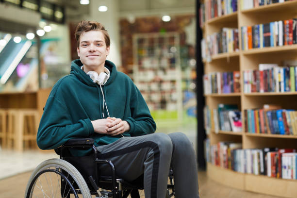 content disabled student in library - handicapped imagens e fotografias de stock