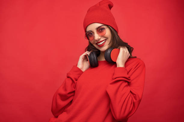 Content girl in red outfit and sunglasses stock photo