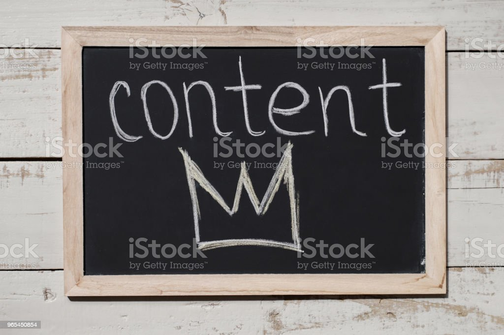 """Content is a King concept. Content marketing. Blackboard with handwritten text """"Content"""" and crown. Digital marketing zbiór zdjęć royalty-free"""
