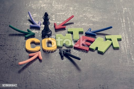 istock Content is king in advertising and communication concept, colorful arrows pointing to the word CONTENT at the center with chess king on black cement wall, creativity of brand website and social media 928695642