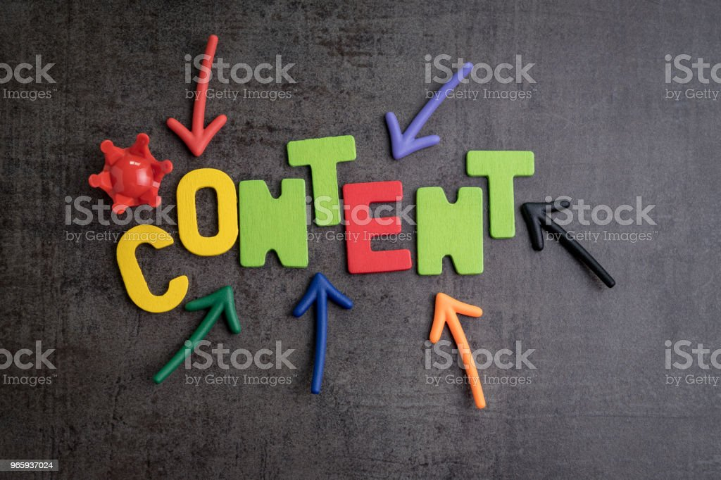 Content is king in brand communication and advertising concept idea, colorful arrows pointing to the word CONTENT at the center with red crown on black cement wall - Royalty-free Advertisement Stock Photo