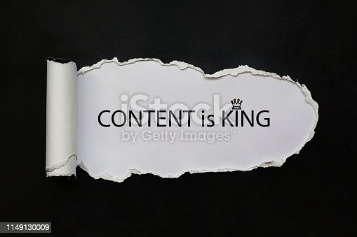 Content is king text appearing behind ripped black paper.